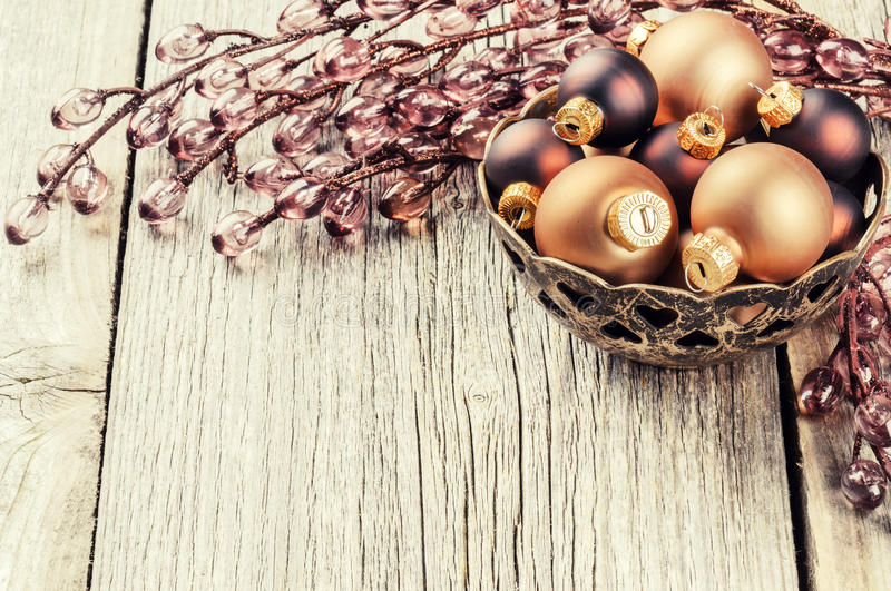 Christmas setting with baubles and garland in brown tone royalty free stock photography