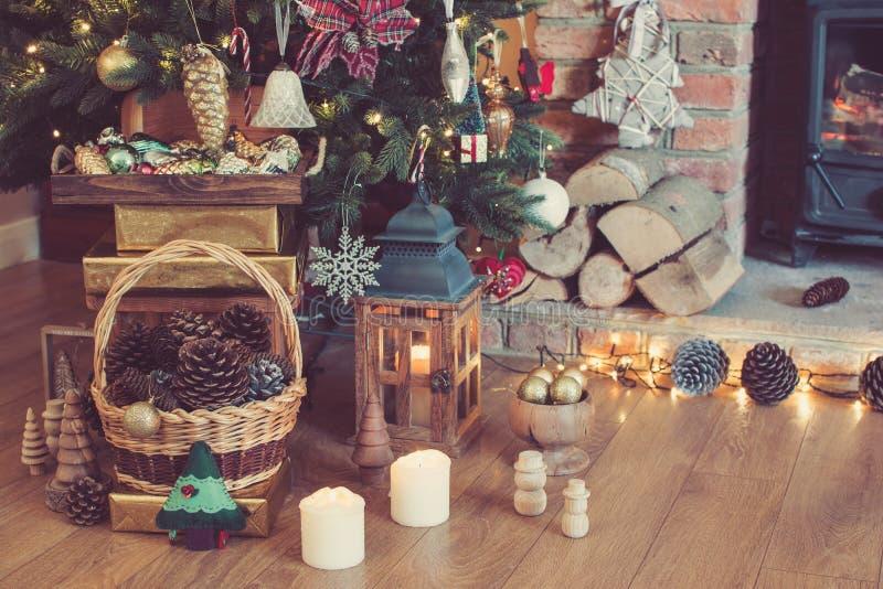 Christmas setting, decorated fireplace, fur tree stock photos