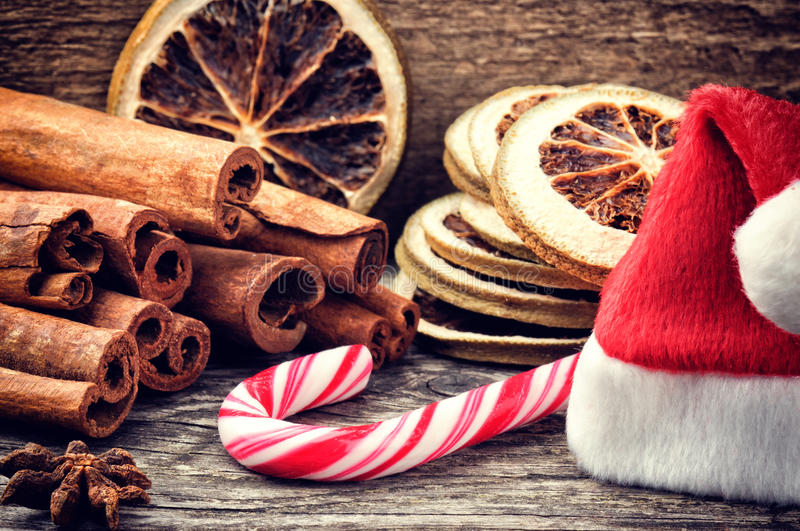 Christmas setting with festive spices and candy cane royalty free stock images