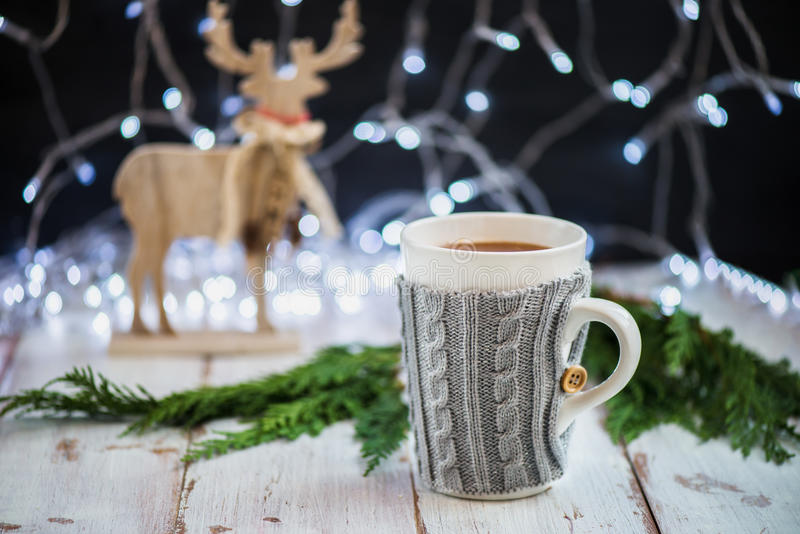 Christmas Setting with Hot Chocolate in a Fancy Sweater Mug royalty free stock image