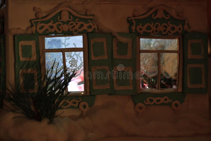 Christmas shining windows with New Year tree royalty free stock photography