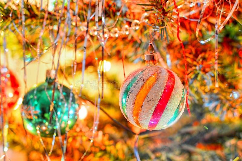 Christmas shiny ball. Shiny christmas ornamental ball hangs on christmas tree stock photos