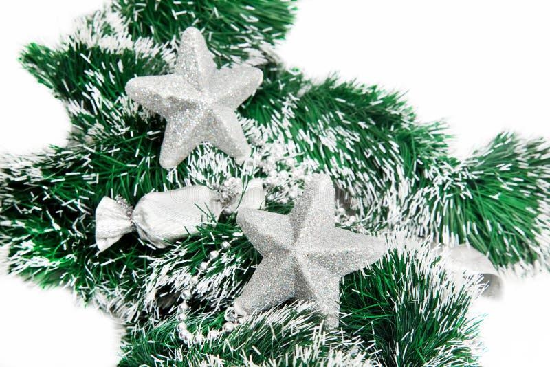 Download Christmas Shiny Stars On Green Tinsel Stock Photo - Image: 27609406