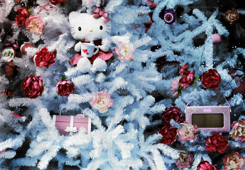 Christmas shop window. With a kitty in a tree and a little frame for some text royalty free stock images