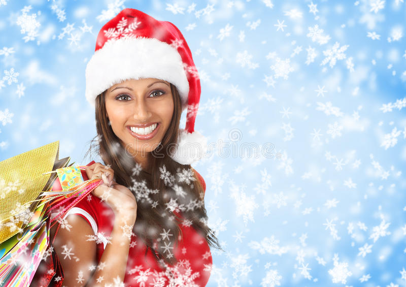Christmas shopping. Smiling Santa woman . Over blue background royalty free stock photos