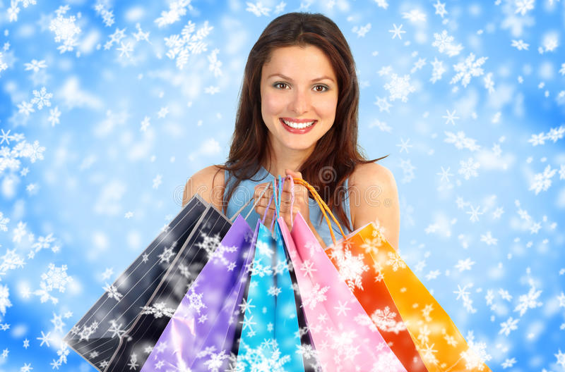 Christmas shopping. Smiling woman . Over snow background stock photography