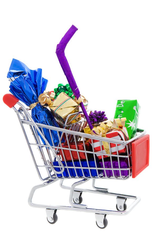 Christmas shopping cart. Shopping cart full of different christmas presents on a white background stock photography