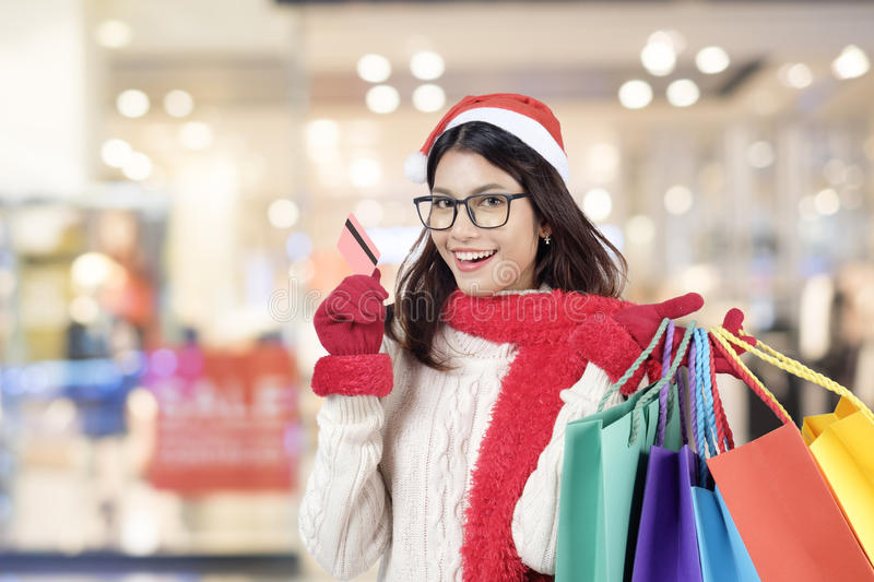 Christmas Shopping. Christmas Sales. Christmas Shopping. Happy Girl With Credit Card In Shopping Mall. Shopping Bags. Shopping Center. Christmas Sales royalty free stock photos