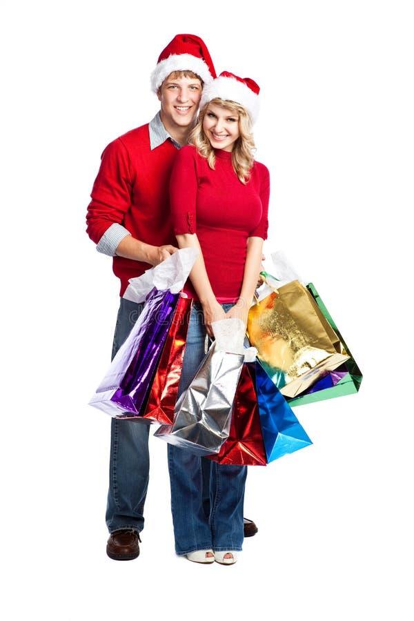 Christmas Shopping Couple Stock Images