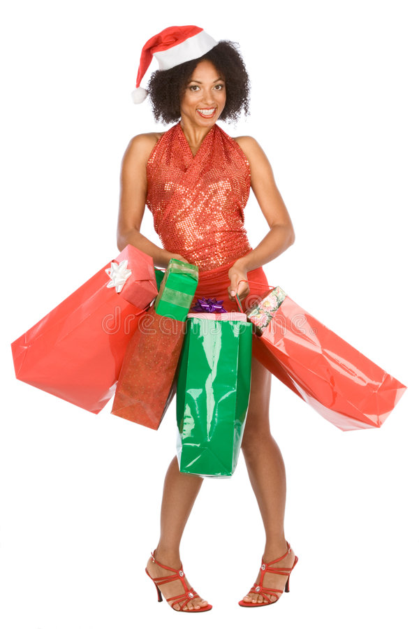 Christmas shopping, ethnic woman with lot of gift stock photography
