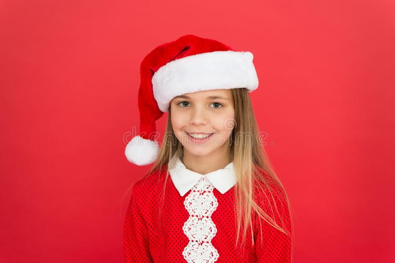 Christmas shopping. New year party. Santa claus girl. Happy winter holidays. Present for xmas. Carefree childhood. Little girl child in santa red hat. Believe royalty free stock photos
