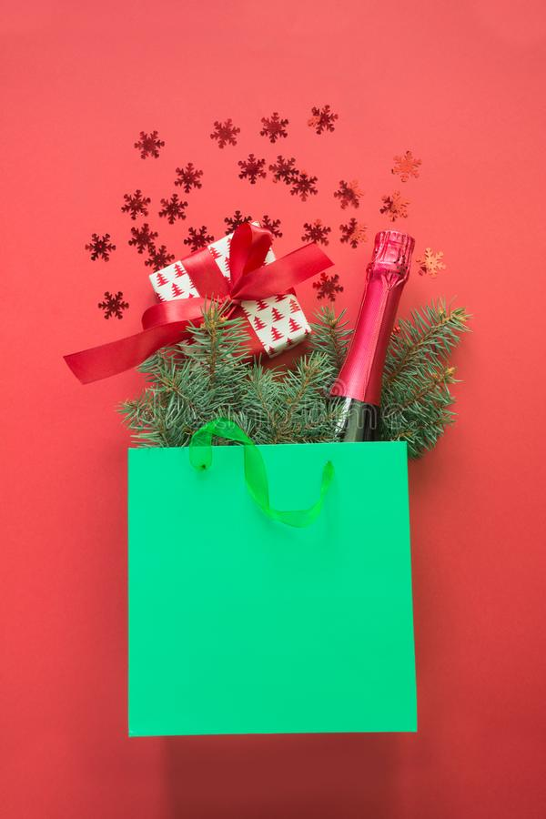 Free Christmas Shopping Paper Bag With And Gift Box And Champagne Stock Images - 163426904