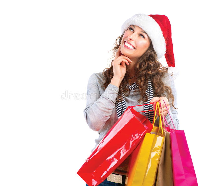 Christmas Shopping. Sales. Christmas Shopping. Woman with Bags over White. Sales royalty free stock photography