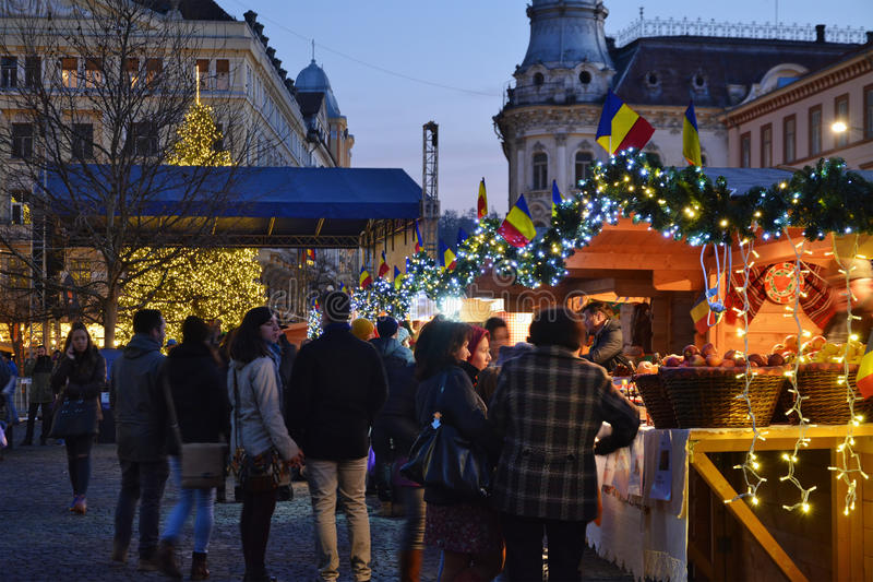 Christmas shopping at traditional market chalets. CLUJ-NAPOCA, ROMANIA - DECEMBER 5, 2015: Unidentified people do Christmas shopping at traditional market stock images