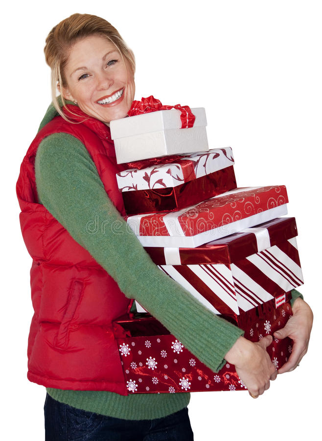 Christmas Shopping Woman. A woman with an armful of presents after going christmas shopping. Photo isolated on a white background stock images