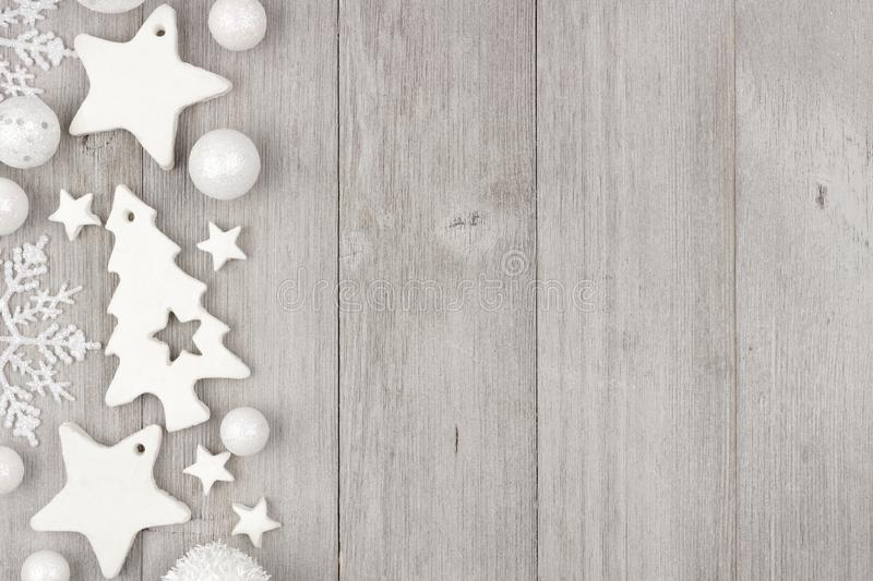 Download Christmas Side Border With White Ornaments On Gray Wood Stock Photo