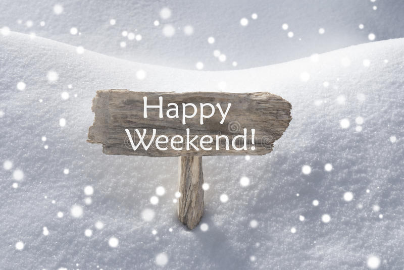 Christmas Sign Snow And Snowflakes Happy Weekend. Wooden Christmas Sign With Snow In Snowy Scenery. English Text Happy Weekend For Seasons Greetings Or Christmas stock images