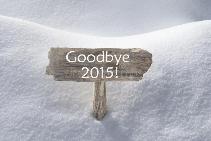 Christmas Sign With Snow And Text Goodbye 2015 royalty free stock photos