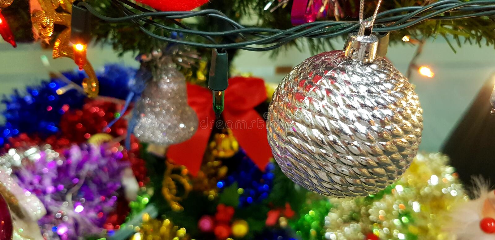 Christmas silver ball decorate on tree with light background for celebration festival and party for background royalty free stock images