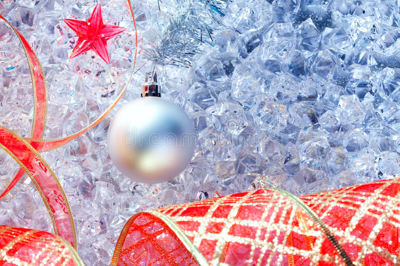Christmas Silver Bauble And Red Ribbon On Ice Royalty Free Stock Image