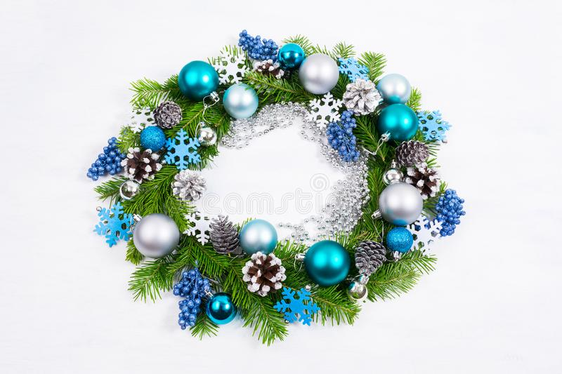 Christmas silver, blue, turquoise balls and pine cones wreath royalty free stock image