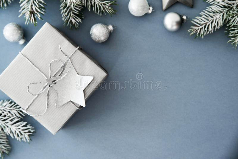 Christmas and New Year holiday background. Xmas greeting card. Winter holidays. Christmas silver gifts, presents, ornaments on blue holiday background top view stock image
