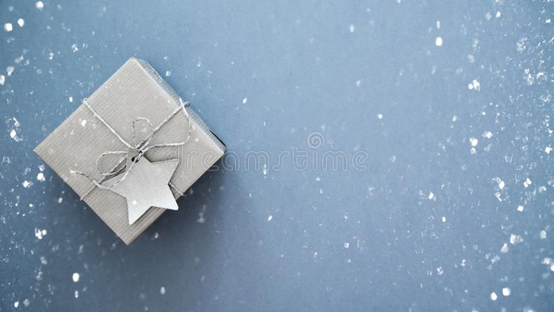 Christmas handmade gift boxes on white marble background top view. Merry Christmas greeting card, frame. Winter xmas holiday theme. Christmas silver handmade royalty free stock image