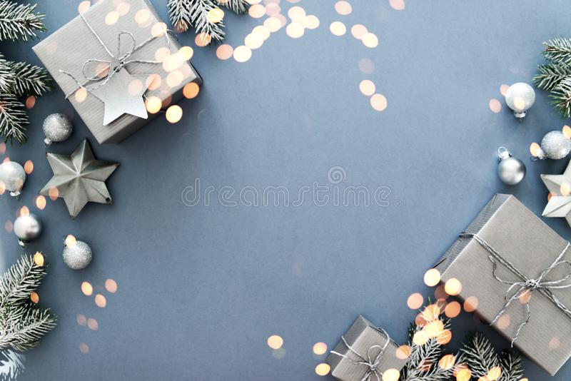 Christmas silver handmade gift boxes on blue background top view. Merry Christmas greeting card, frame. Winter xmas holiday theme. Happy New Year. Flat lay stock image