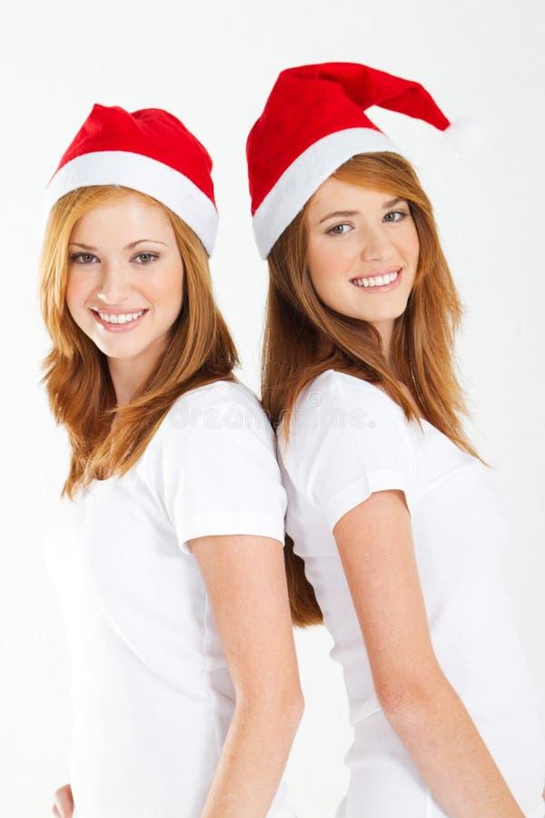 Christmas sisters stock photography