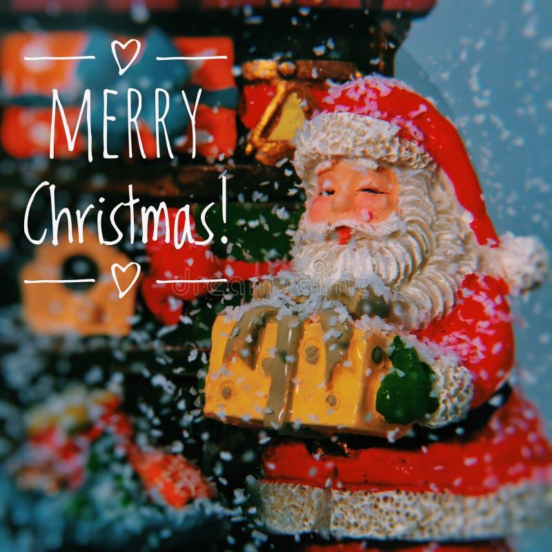 Christmas snow ball with Santa and gifts inside stock image