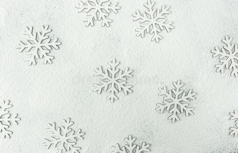 Christmas Snow Flakes Silhouette Pattern on Snowy White Background Powdered with Flour. New Year Holiday Greeting Card.Baking. Christmas Snow Flakes Silhouette royalty free stock photo