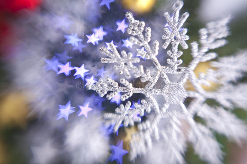 Christmas snowflake. On the lights background royalty free stock photography