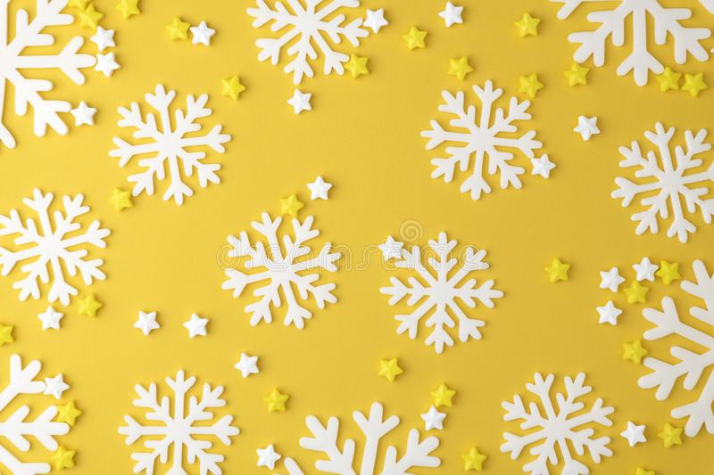 Christmas snowflake pattern with Lollipops sweets and Candy on yellow pastel background. Minimal concept royalty free stock image