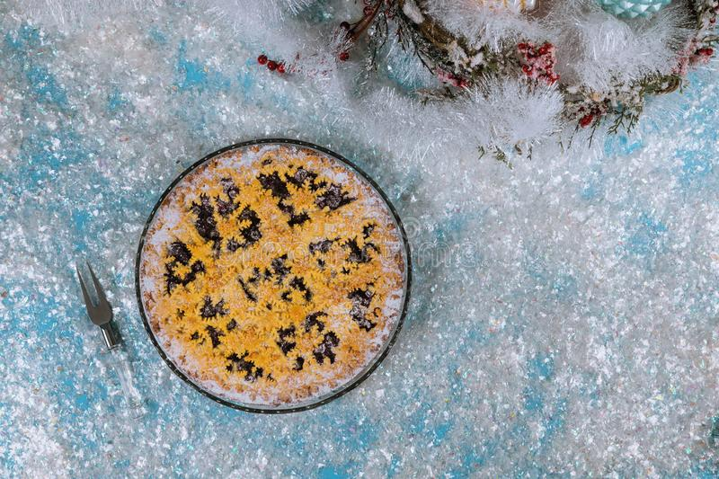 Christmas snowflake pie on frosty snow. New Year and Holidays concept stock images