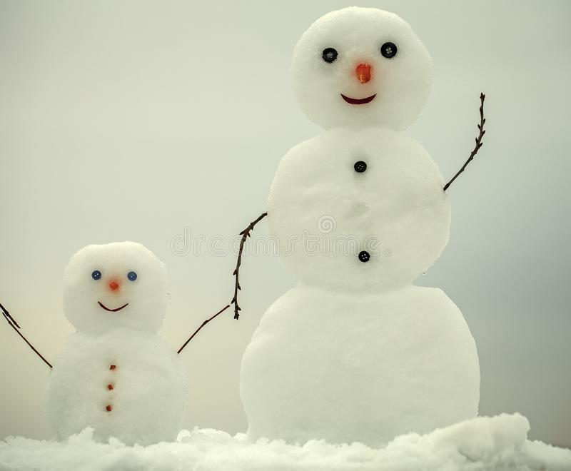 Christmas snowman family, mother or father and child in winter stock photos