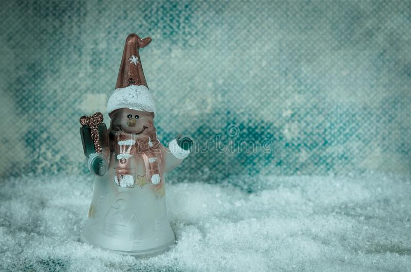 Christmas snowman figure decoration against blue snowy background stock images