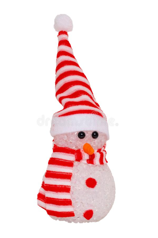 Christmas snowman isolated. Close-up of a happy cute winter snowman with red white striped hat and scarf isolated on a white royalty free stock photos