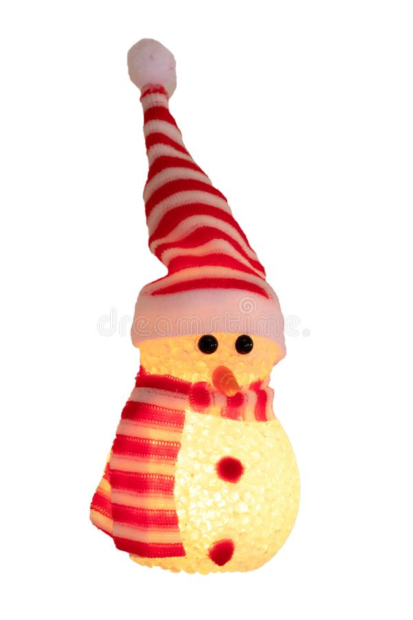Christmas snowman isolated. Close-up of a yellow illuminated happy cute winter snowman with red white striped hat and scarf royalty free stock photos