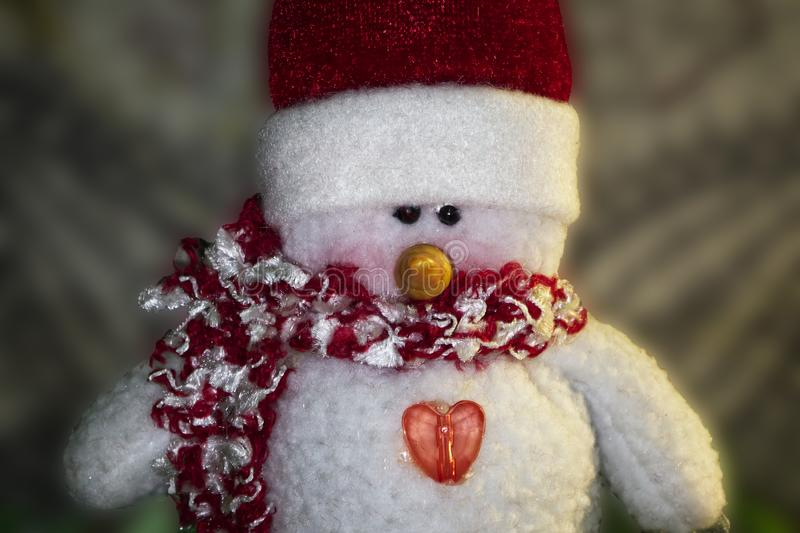 Christmas Snowman puppet with red hat and scarf. royalty free stock images