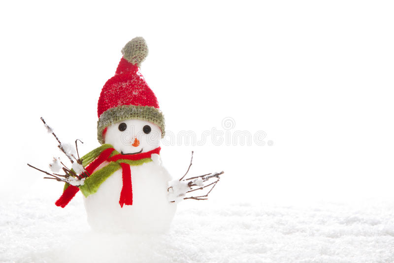 Christmas: snowman with red scarf and hat on white background. Winter concept or idea for a greeting card stock photos