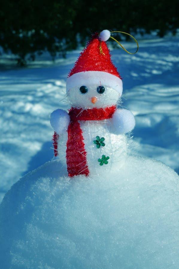 Christmas Snowman in snow stock photos