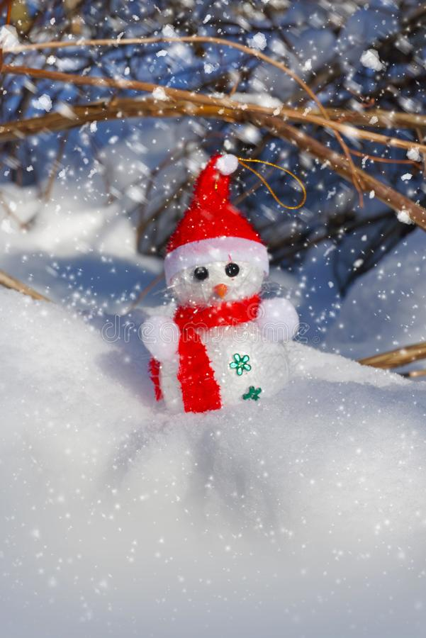 Christmas Snowman in snow royalty free stock photo