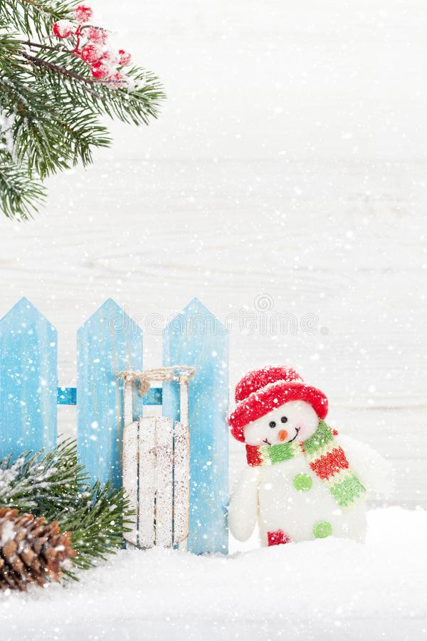 Christmas snowman toy, decor and fir tree branch. Xmas greeting card with space for your greetings stock images