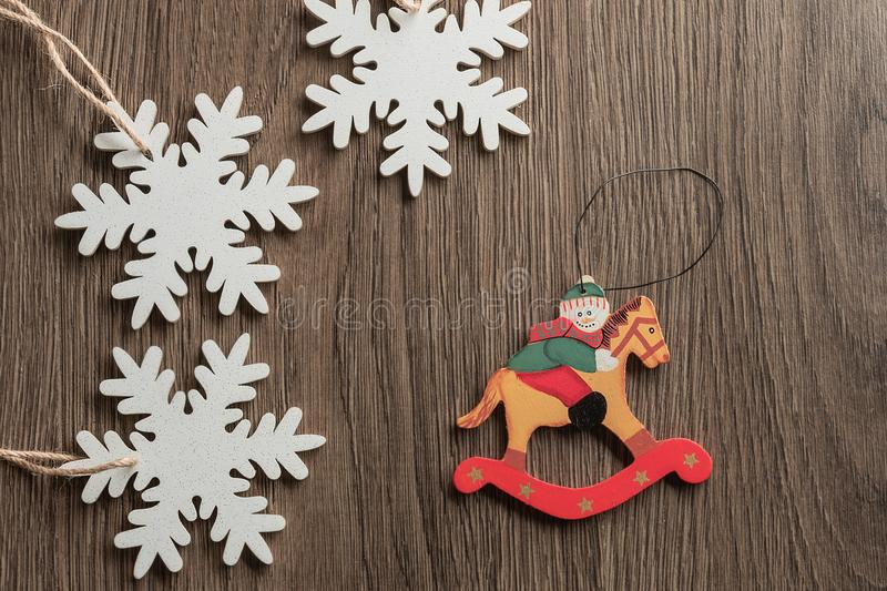 Christmas snowman and white snowflakes in rustic style on  background royalty free stock image