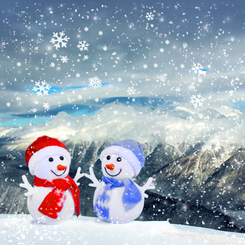 Christmas snowmans in mountains and snow. Christmas decorations snowmans in mountains and snow. Winter holidays concept stock images