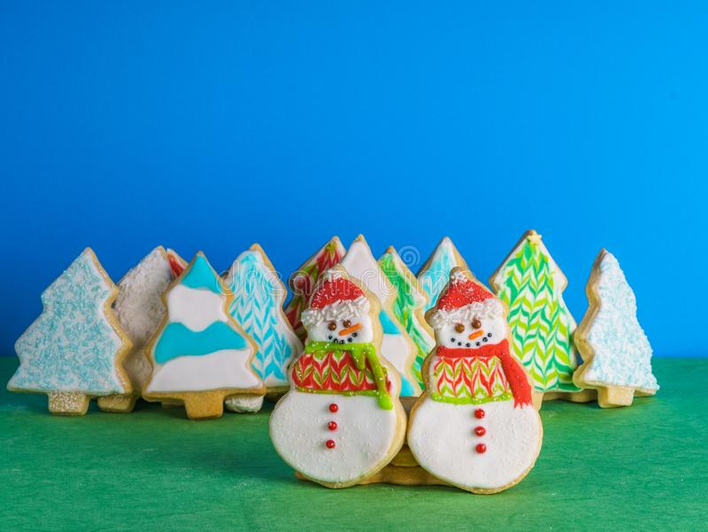 Christmas snowmans and trees ont eh background cookies winter composition. Christmas snowmans and trees ont eh background cookies winter composition stock images