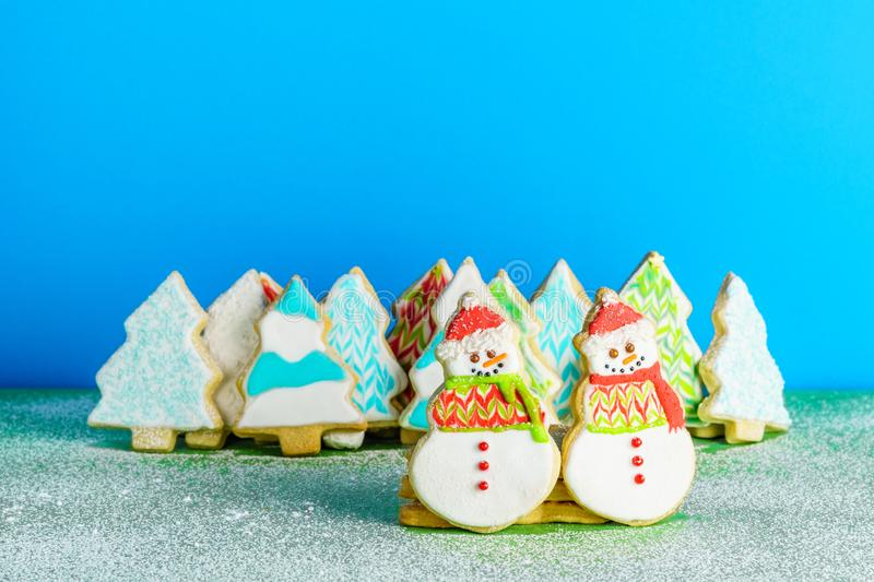 Christmas snowmans and trees ont eh background cookies winter composition. Christmas snowmans and trees ont eh background cookies winter composition royalty free stock image