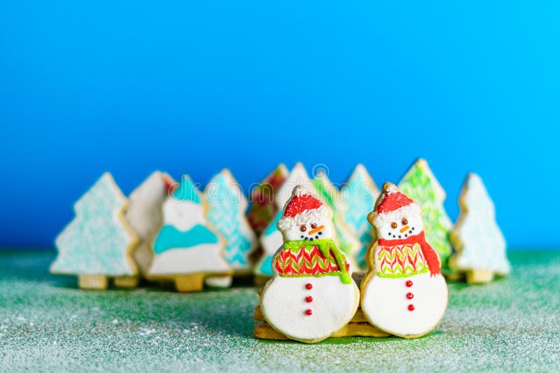 Christmas snowmans and trees ont eh background cookies winter composition. Christmas snowmans and trees ont eh background cookies winter composition royalty free stock photography
