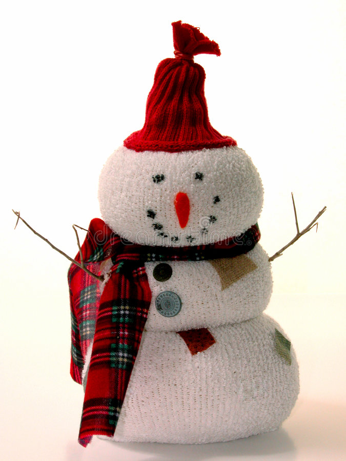 Christmas: Snowy the Snowman. This little guy was a craft project made with socks and rice as gifts for family. Shot on a white background