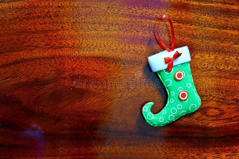 Christmas socks. On a background of brown wood royalty free stock image